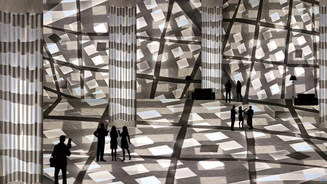 משרבייה אדריכלית מקולאז' חיתוך נייר בשילוב תאורה